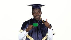 Graduierte Holding eine Green Card weiß Abschluss oben stock footage