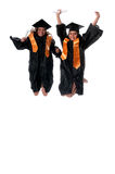 Gradutes jumping Stock Photos
