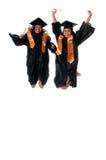 Gradutes jumping Stock Photos