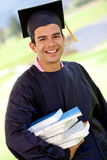 Gradution student carrying books Stock Images