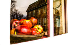 Apples in a wooden bowl with reflection Stock Photos