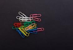 Graffette colorate su un fondo nero Fotografia Stock Libera da Diritti