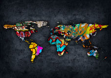 Graffit world map. Grungy world map wit graffiti elements Royalty Free Stock Photo