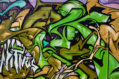 Graffiti. Street Art Graffiti spray painted on a concrete wall Royalty Free Stock Photo