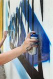 Graffiti. Painting on wall,  graffiti - modern urban culture Stock Photos