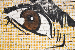 Graffiti. The image of an Eye on a brick wall Stock Images