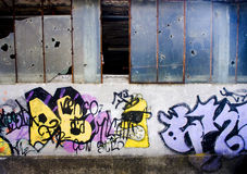 Graffiti. On the old wall with broken glass Royalty Free Stock Photos