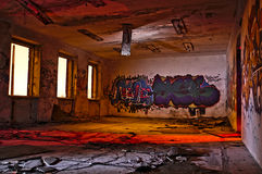 Graffiti in abandoned industrial building. Tallinn, Estonia. Taken by night, pitch black, artificial illumination by gelled strobes Stock Illustration