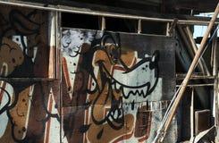 Graffiti of a Dog on Abandoned Shack Royalty Free Stock Images