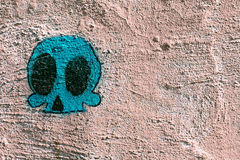 Graffiti abstract background with the drawn skull. Graffiti background with the drawn skull royalty free stock photos