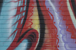 Graffiti abstrait sur le mur de briques Photo stock