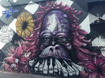 Graffiti - Affe/Gorilla mit Klavier-Schlüsseln Stockfotografie