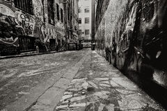 Graffiti Alley. Alley, with dumpsters, covered in graffiti.  Added grain Stock Photos