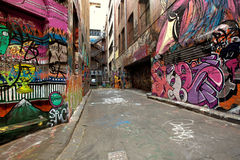 Graffiti Alley. Hosier Lane, Melbourne, Australia - October 27, 2011:  Graffiti-covered walls in old alley Royalty Free Stock Image