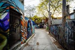 Graffiti in an alley in Kensington Market, Toronto, Ontario. Royalty Free Stock Photos