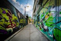 Graffiti in an alley in Kensington Market, Toronto, Ontario. Stock Photography