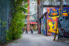Graffiti in an alley in West Queen West, in Toronto, Ontario. Royalty Free Stock Photos