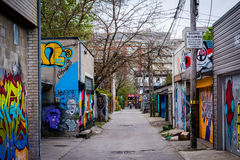 Graffiti in an alley in West Queen West, in Toronto, Ontario. Royalty Free Stock Photo
