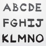 Graffiti alphabet part 1. Black isolated grunge graffiti alphabet font part 1 Royalty Free Stock Images