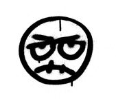 Graffiti angry emoji sprayed in black over white Royalty Free Stock Photography