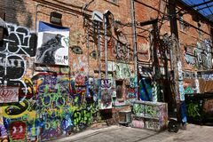 Graffiti art in alley of Rapid City, SD. RAPID CITY, SOUTH DAKOTA, May 23, 2018: The paint graffiti art is found in Art Alley, Rapid City began as a public art stock images