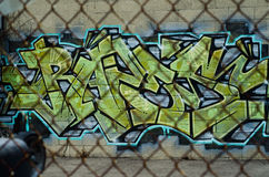 Graffiti art through fence Stock Photos