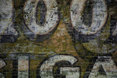 Graffiti Art Layers. Years of different brick building ads blend together to create art Stock Image