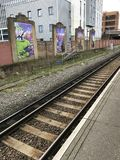 Graffiti art in UK. Publicity and advertising, Graffiti art in UK, wooden train rails royalty free stock photography