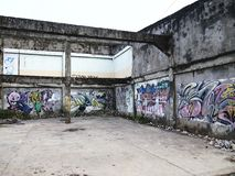 Graffiti art on a wall of an abandoned building structure in Antipolo City, Philippines. ANTIPOLO CITY, PHILIPPINES - MARCH 1, 2016: Graffiti art on a wall of royalty free stock photography