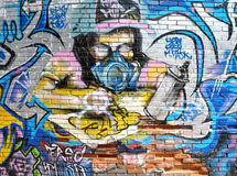 Graffiti Artist. Painting on a wall Stock Photography