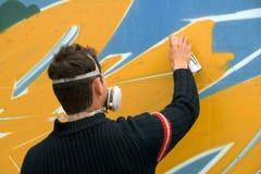 Graffiti artist. A young graffiti art at work Stock Image