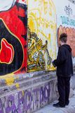 Graffiti artist creating graffiti at Athens. Graffiti artist create graffiti to the wall at Athens Greece February 2018 Royalty Free Stock Photography