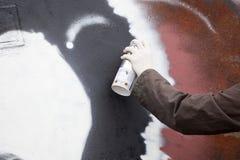 Graffiti artist draws. On the wall royalty free stock photo