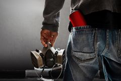 Graffiti artist hold gas mask Royalty Free Stock Images