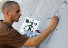 Graffiti artist painting Stock Image