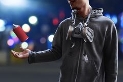 Graffiti artist pose on the street. At night Royalty Free Stock Photography