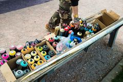 Graffiti artist with spray cans and accessories Royalty Free Stock Photo