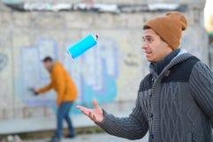 Graffiti artist before spraying brick wall Stock Images