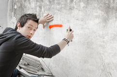 Graffiti artist surprised in action Royalty Free Stock Image