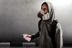 Graffiti artist wearing respirator mask. Holding spray can Royalty Free Stock Image