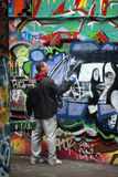 Graffiti artist at work. Creating new images on a wall, London Royalty Free Stock Images