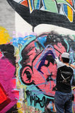 Graffiti Artist at work in Macau Royalty Free Stock Photo