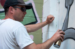 Graffiti Artist At Work On Mural Stock Image
