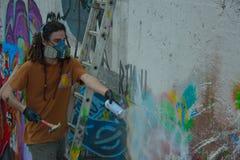 Graffiti Artist at work on a new creation Stock Photo