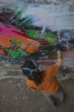 Graffiti Artist at work on a new creation Royalty Free Stock Photography