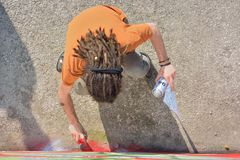 Graffiti Artist at work on a new creation Royalty Free Stock Photo