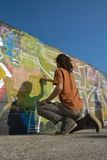 Graffiti Artist at work on a new creation Royalty Free Stock Images