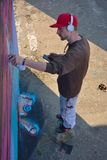 Graffiti Artist at work on a new creation Royalty Free Stock Photos