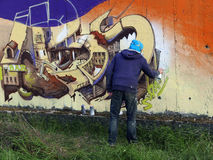 Graffiti artist at work. Graffiti artist at work signing his work Royalty Free Stock Image