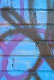Graffiti Artwork Covers Brick Wall Stock Photography